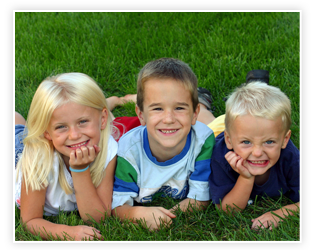 three kids on grass